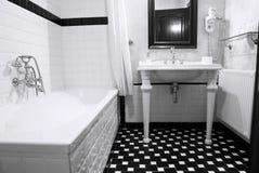 Bathroom. In classic english style, black and white, foam bath Stock Photo