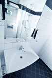 Bathroom. Wide angle perspective of hotel bathroom with sink and shower Royalty Free Stock Images