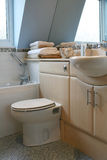 Bathroom. Interior of modern bathroom with fitted cabinets Royalty Free Stock Photography