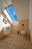 Bathroom. Cozy bathroom with a window at the blue sky Stock Photos