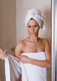 At the bathroom. Girl is getting ready to take a bath, spa and wellness concept stock images