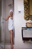 At the bathroom. Beautiful girl is etting ready to take bath stock image