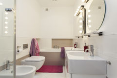 Bathroom. Elegant and modern bathroom with pink additions Stock Image