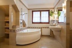 Bathroom. Contemporary bathroom interior, big bath and window Royalty Free Stock Photo