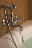 Bathroom. Chrome tap with water flowing Royalty Free Stock Photos