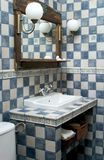 Bathroom. Rustic bathroom white and blue-coloured stock photography