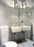 Bathroom. Small,white bathroom with big mirror stock image