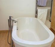 Bathroom. White modern bathtub in a bathroom Royalty Free Stock Photography