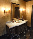 Bathroom. With marble countertop and sink Royalty Free Stock Image