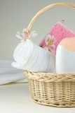 Bathroom accessories. Basket with bathroom accessories anf flowers Royalty Free Stock Photo