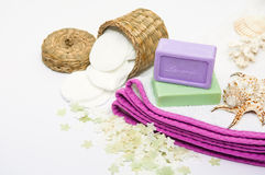 Bathroom accessories in purple tones. Bathroom accessories and natural lavender soap in composition decorated with seashells Royalty Free Stock Image