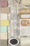 Bathroom accessories. Set of bathroom accessory on stone tile: soaps, bath salt, clay, sponges, loofa and starfish. Top view point Stock Images