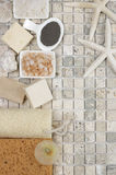 Bathroom accessories. Set of bathroom accessory on stone tile: soaps, bath salt, clay, sponges, loofa and starfishes. Top view point Stock Photography
