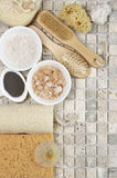 Bathroom accessories. Set of bathroom accessory on stone tile: soaps, bath salt, clay, sponges, loofa. Top view point Royalty Free Stock Photos