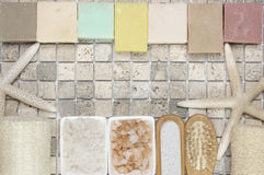 Bathroom accessories. Set of bathroom accessory on stone tile: soaps, bath salt, loofa and starfishes. Top view point Stock Image