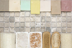 Bathroom accessories. Set of bathroom accessory on stone tile: soaps, bath salt, loofa. Top view point Stock Photo