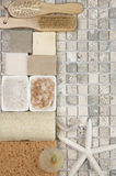 Bathroom accessories. Set of bathroom accessory on stone tile: soaps, bath salt, sponges, loofa, brushes and starfish. Top view point Stock Photography