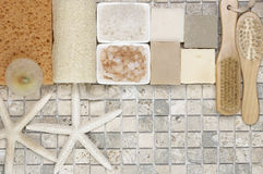 Bathroom accessories. Set of bathroom accessory on stone tile: soaps, bath salt, sponges, loofa, brushes and starfishes. Top view point Royalty Free Stock Image