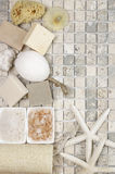 Bathroom accessories. Set of bathroom accessory on stone tile: soaps, bath salt, sponges, loofa and starfishes. Top view point Royalty Free Stock Image