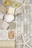Bathroom accessories. Set of bathroom accessory on stone tile: soaps, bath salt, sponges, loofa and starfishes. Top view point Royalty Free Stock Photos