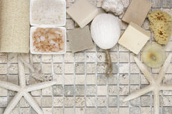 Bathroom accessories. Set of bathroom accessory on stone tile: soaps, bath salt, sponges, loofa and starfishes. Top view point Royalty Free Stock Photo