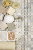Bathroom accessories. Set of bathroom accessory on stone tile: soaps, bath salt, sponges, loofa. Top view point Stock Photography