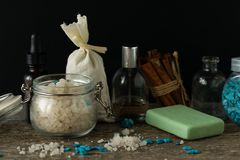 Bathroom accessories soap oils sea salt lavender aroma sachet on. Wooden desk toned Stock Images
