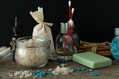 Bathroom accessories soap oils sea salt lavender aroma sachet on. Wooden desk toned Royalty Free Stock Photos
