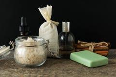 Bathroom accessories soap oils sea salt lavender aroma sachet on. Wooden desk toned Stock Photography