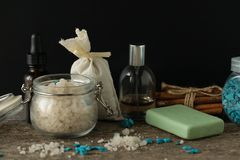 Bathroom accessories soap oils sea salt lavender aroma sachet on. Wooden desk toned Royalty Free Stock Photography
