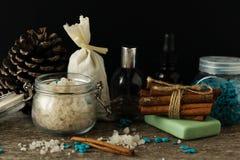 Bathroom accessories soap oils sea salt lavender aroma sachet on. Wooden desk toned Stock Image