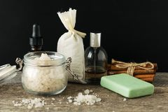 Bathroom accessories soap oils sea salt lavender aroma sachet on. Wooden desk toned Stock Photo