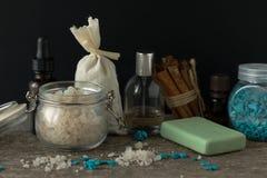 Bathroom accessories soap oils sea salt lavender aroma sachet on. Wooden desk toned Royalty Free Stock Photo