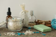 Bathroom accessories soap oils sea salt lavender aroma sachet on. Wooden desk toned Royalty Free Stock Images