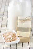Bathroom accessories. Stack of various natural soaps, bath salt, shower gel and lotion on stone tile Stock Images