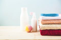 Bathroom accessories - towels, cream, bath foam and shampoos on a light, bright background Concept of caring for yourself, your bo. Dy Place for copy space Stock Image