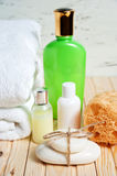 Bathroom accessories and white towel. Soap and lotion. Beauty care accessories for bath. Stock Images