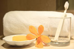 Bathroom amenities. Yellow soap and orchids in a wellness resort Stock Photo