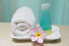 Bathroom amenities. With towel and frangpani Royalty Free Stock Image