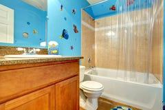 Bathroom with an aqua designed wall. Beige bathroom with designed blue wall stock photos