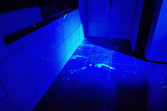 Bathroom as place of crime in UV light Royalty Free Stock Photography