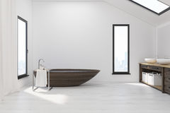 Bathroom in attic with wooden tub Stock Image