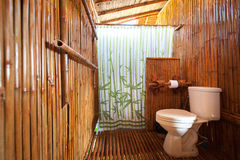 Bathroom bamboo with masonry shower cubicle Stock Images