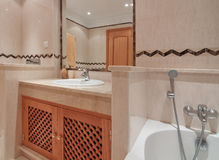 Bathroom with bath and a mirror in a  hotel. Royalty Free Stock Images