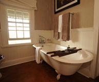 Bathroom with bathtub. A view of the interior of a bathroom including a large bathtub.  Intentionally blurring Royalty Free Stock Photo