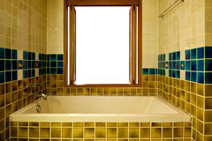 Bathroom with bathtub and open window Stock Images