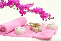 Bathroom beauties. Bathroom composition with towels, an orchid, candles and soap Stock Image