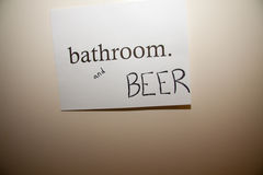 Bathroom and Beer Royalty Free Stock Image