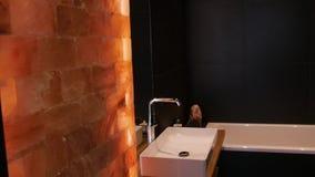 Bathroom black dark wood sink bath luxury interior wall clean hotel decor design.  stock video