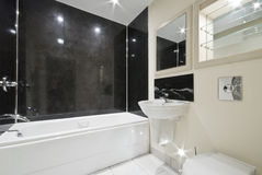 Bathroom with black stone tiles. Contemporary bathroom with natural black stone tiles Stock Photography